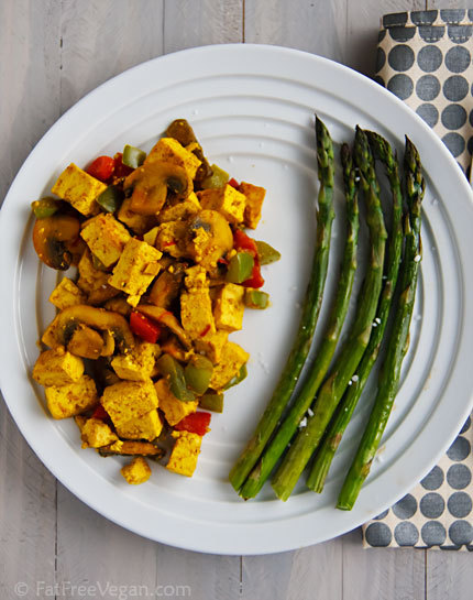 lowcalorierecipes:  Ridiculously Easy Curry-Scrambled Tofu Ingredients: 1/2 green pepper, chopped (12) 1/2 red pepper, chopped (18) 8 ounces mushrooms, trimmed and sliced (50) 2 cloves garlic, minced or pressed (9) 14 ounces extra-firm tofu, drained, dried off, and cubed or crumbled (361) 1 teaspoon good curry powder (7) 1/8 teaspoon ground red pepper (1) 1/4 cup vegetable broth (10) 1 teaspoon salt (0) 1 tablespoon nutritional yeast (35) Directions: Heat a non-stick skillet. Spray it lightly with pan spray if you wish and add the chopped peppers and mushrooms. Cook until they begin to soften, about 2 minutes. Add the garlic and cook another minute or two until mushrooms have darkened in color. Stir in the tofu, sprinkle it with curry powder and ground red pepper, and pour the vegetable broth over it. Cook on medium-high, turning gently with a spatula, until most of the liquid is evaporated and tofu is hot and beginning to brown in places. Stir in salt to taste along with nutritional yeast and black salt, if using. Keep warm until ready to serve, makes 3 servings. Nutritional information per serving: 168 calories; 8.5g total fat; 0.8g sat fat; 0mg cholesterol; 857mg sodium; 17.9g protein; 3.2g dietary fiber;