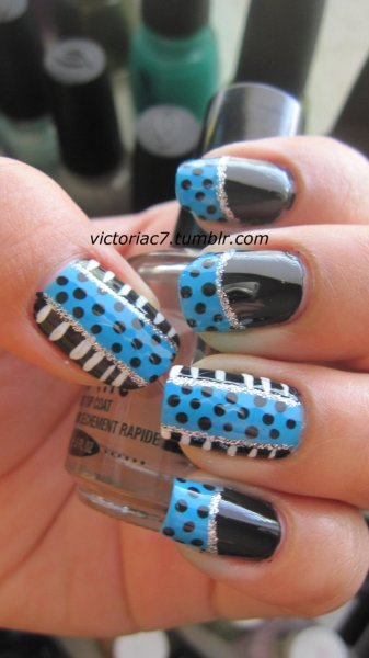 Messing around some more with polka dots. Colors used:  Jordana - Black Sally Hansen X-treme Wear - Blue Me Away LA Colors Striper - White LA Colors Striper - Silver Glitter
