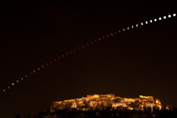 "Eclipse over the Acropolis The total phase of the June 15 lunar eclipse lasted an impressive 100 minutes.  Its entire duration is covered in this composite of a regular sequence of digital camera exposures, tracking the dark lunar disk as it arced above the Acropolis in Athens, Greece.  In fact, around 270 BCE Greek astronomer Aristarchus also tracked the duration of lunar eclipses, though without the benefit of digital clocks and cameras.  Still, using geometry, he devised a simple and impressively accurate way to calculate the Moon's distance, in terms of the radius of planet Earth, from the eclipse duration.  A more modern Greek astronomer, Elias Politis titled this eclipse duration study and the accompanying youtube timelapse video ""Acropoclipse""."