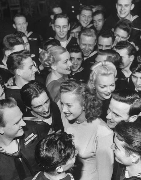Goldwyn Girls mingle with Navy men during WW2 - c. 1940s