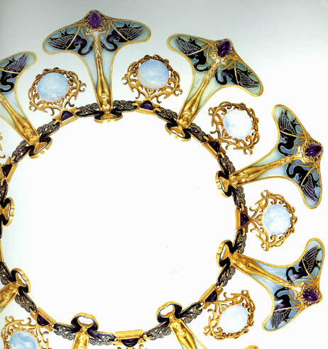 """Lalique designed one of his most famous and incredible necklace for the Parisian exposition.  Handcrafted in gold with nine nude female figurines standing on amethyst stones with black swans on each side of her feet, in between the figures are round opals all suspended from an ornately curved enameled neck ring."""
