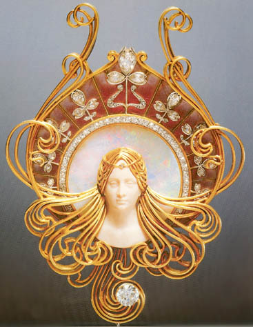 """Rene Lalique became one of France's leading jewelers in the art nouveau style. He designed very ornate jewelry and headdresses for the actress Sarah Bernhardt.  She wore his jewelry on stage as costumes and off stage as her own personal collection."""