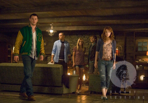 See the first image from Cabin In The Woods Finally proof that Joss Whedon's Cabin In The Woods really does exist! The first ever still from the long-delayed horror flick has been revealed online.Showing off Thor's  Chris Hemsworth in full-on jock mode, the image also gives us our first  glimpse of the cabin in question – which looks rather luxurious,  actually.Directed by Drew Goddard (writer of Cloverfield) and produced by Buffy creator  Joss Whedon, the film has been victim to the MGM financial crisis,  meaning it's yet to be released despite being completed years ago…
