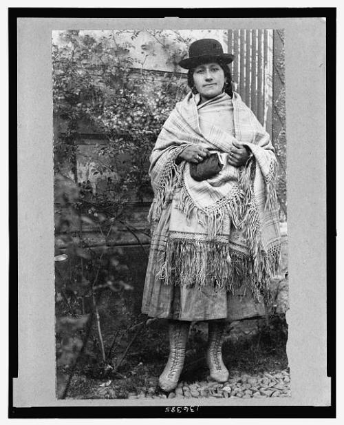 """Chola Cook""  Photographed in La Paz, Bolivia by Frank G. Carpenter ca. 1900-1923.  At the Library of Congress."