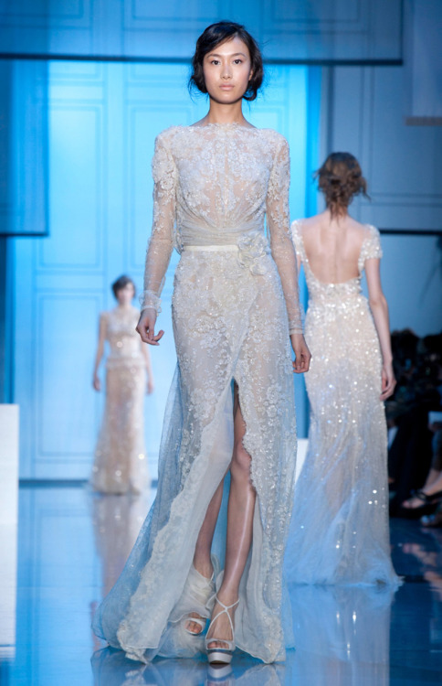 tmagazine:  The master of evening gowns, Elie Saab doesn't disappoint with pearl embroideries, 30's silhouettes, and a cool palette of ivories, skin tones, and inky blues and teals.