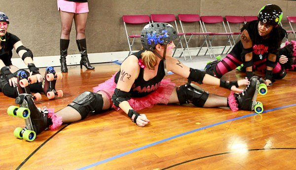 Punk N. Drublic, The Jenerator, and DiNAh Might stretching before the game  Photo: Jennifer Slak