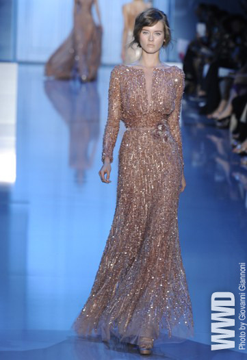 Elie Saab Fall Couture 2011 Though the designer's collection was inspired by skyscrapers, his models were graceful as reeds in their gauzy column dresses.