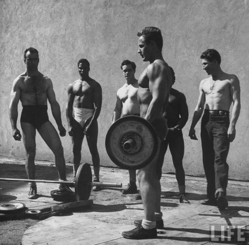 mikestand:  Prisoners at San Quentin weightlifting in prison yard during recreation period, 1947.  http://theselvedgeyard.wordpress.com  I put weight on my deadlift at the gym tonight, only a little but still they were fun. then I did a tabata workout of squats and sit ups and died a little bit