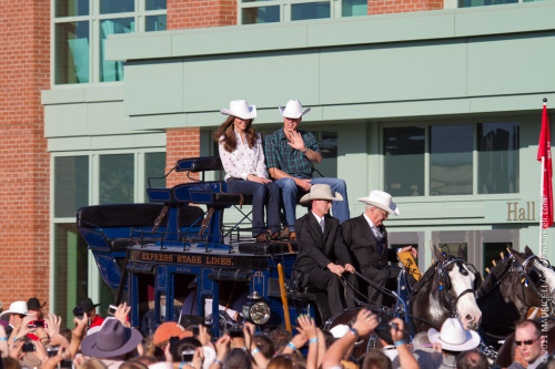 Will and Kate arrived at the BMO Centre in true stampede style: on a stage coach, wearing the white cowboy hats that were presented to them by the Mayor of Calgary upon their arrival. Giddy up!
