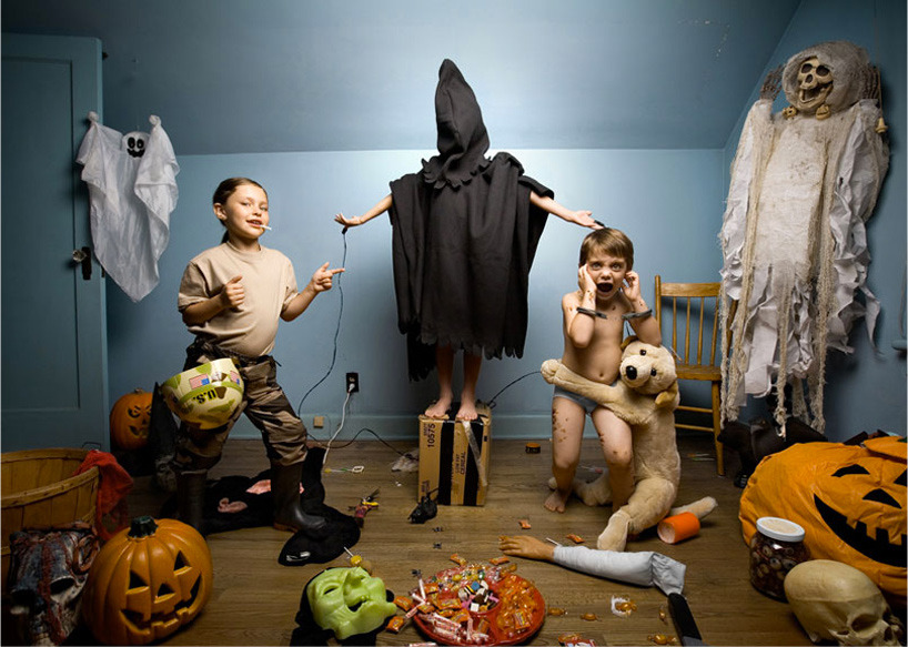 'In the playroom' by canadian photographer and art director jonathan hobin is a series of images that depict children reenacting major current events and headlines of our time. including major news items such as 9/11, hurricane katrina, the north korean missiles, and the jonbenét ramsey trials, the collection juxtaposes the often devastating themes with the high-spirited setting of a kid's playroom. utilizing relevant props - dolls, plastic toys, stuffed animals - with bright and playful backdrops,