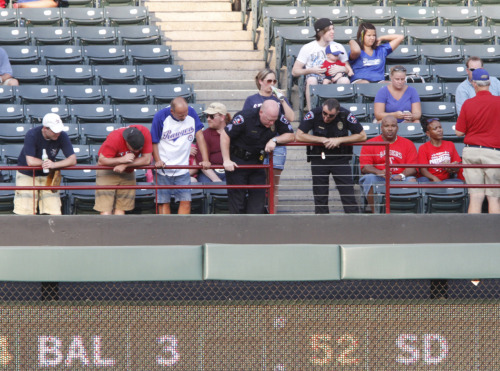 ARLINGTON, Texas (AP)  - The Texas Rangers say a fan died after falling out of the stands while trying to catch a baseball tossed his way during the game.