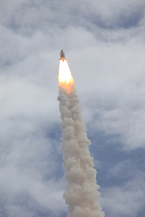 The Space Shuttle Atlantis lifts off embarking on the final mission of NASA's 30-year shuttle program.