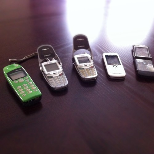 Prepping for our yard sale when I stumbled upon my cell phone grave yard.  (Taken with instagram)
