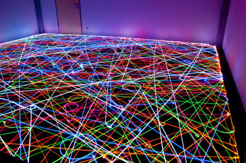 drrty: super slow photography of roomba vacuums with lights attached creating neon carpetscapes