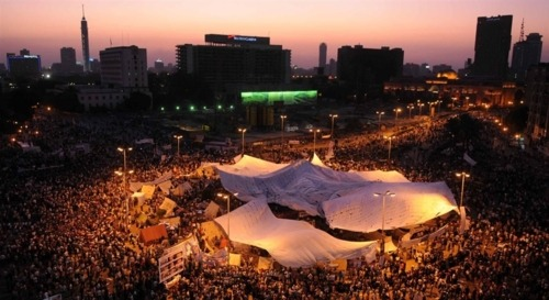 newsflick:  Thousands of Egyptian protest in Cairo's Tahrir Square in the evening hours of July 8, 2011. The nationwide demonstrations were called to defend the uprising that toppled President Hosni Mubarak and to show anger at the new military rulers' slow pace of reforms. (Mohamed Hossam)