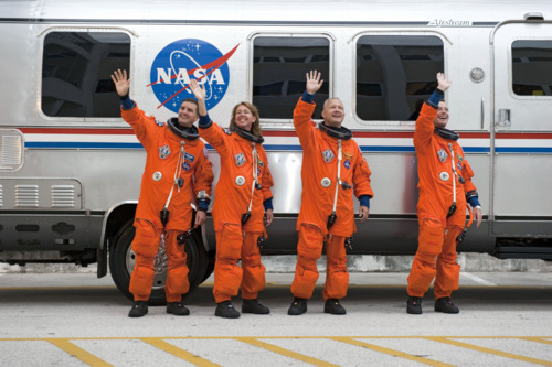 STS135-S-025 (8 July 2011) —- After suiting up, the STS-135 crew  members pause alongside the Astrovan to wave farewell to onlookers  before heading for launch pad 39A for the launch of space shuttle  Atlantis on the STS-135 mission. From the right are NASA astronauts  Chris Ferguson, commander; Doug Hurley, pilot; Sandy Magnus and Rex  Walheim, both mission specialists. Atlantis is scheduled to lift off at  11:26 a.m. (EDT) on July 8 for its mission to the International Space  Station. STS-135 will deliver the Raffaello multi-purpose logistics  module packed with supplies and spare parts for the orbiting outpost.  Atlantis also will fly the Robotic Refueling Mission experiment that  will investigate the potential for robotically refueling existing  satellites in orbit. In addition, Atlantis will return with a failed  ammonia pump module to help NASA better understand the failure mechanism  and improve pump designs for future systems. STS-135 will be the 33rd  flight of Atlantis, the 37th shuttle mission to the space station, and  the 135th and final mission of NASA's Space Shuttle Program. Photo  credit: NASA
