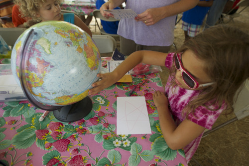 A young attendee learns about where Peace Corps Volunteers serve at the 2011 Smithsonian Folklife Festival