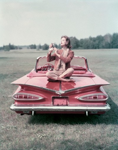If I had a car… also sunglasses…  Via / theniftyfifties:  A model polishes her sunglasses on the wing-back of a 1959 Chevrolet Impala Convertible.  Photo by John Rawlings.