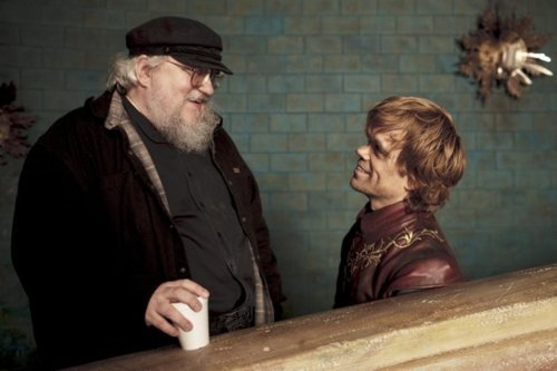 A Song of Ice and Fire author George R. R. Martin exchanges a few laughs with Game of Thrones actor Peter Dinklage (Tyrion Lannister) on set.  I'm in love with this picture.