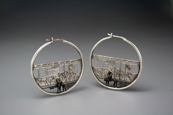 Train Hoops by DMD Metal | Let's Go Shopping! You're anything but a rebel. You always return your books on time, there's no ink on your skin and you've never had a run in with the law. But that doesn't mean you can't wear a bit of rebellion on your ears right? These little train hoops are also customisable - get the designer to write whatever you want in graffitti… even if it is 'i love stamps'.