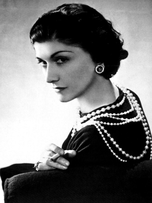"GABRIELLE COCO CHANEL (19 August 1883 – 10 January 1971)  QUOTES ON: BEAUTY Nature gives you the face you have at twenty; it is up to you to merit the face you have at fifty. A woman has the age she deserves. I  don't understand how a woman can leave the house without fixing herself  up a little - if only out of politeness. And then, you never know,  maybe that's the day she has a date with destiny. And it's best to be as  pretty as possible for destiny. One can get used to ugliness, but never to negligence. The best color in the whole world, is the one that looks good, on you!  ELEGANCE Elegance is refusal. Elegance is not the prerogative of  those who have just escaped from adolescence, but of those who have  already taken possession of their future. Elegance does not consist in putting on a new dress. An elegant woman should be able to do her marketing without making housewives laugh. Those who laugh are always right. Find out how Coco Chanel co-invented The Little Black Dress. Adornment, what a science! Beauty, what a weapon! Modesty, what elegance!  FASHION Fashion is not simply a matter of clothes. Fashion is in the air,  born upon the wind. One intuits it. It is in the sky and on the road. Fashion has two purposes: comfort and love. Beauty comes when fashion succeeds. Nothing goes out of fashion sooner than a long dress with a very low neck. Fashion  has become a joke. The designers have forgotten that there are women  inside the dresses. Most women dress for men and want to be admired. But  they must also be able to move, to get into a car without bursting  their seams! Clothes must have a natural shape. Fashion fades, only style remains the same. In fashion, you know you have succeeded when there is an element of upset. Fashion is architecture: it is a matter of proportions. Fashion is made to become unfashionable. It is the unseen, unforgettable, ultimate accessory of fashion that heralds your arrival and prolongs your departure. Why  am I so determined to put the shoulder where it belongs? Women have  very round shoulders that push forward slightly; this touches me and I  say: 'One must not hide that!' Then someone tells you: 'The shoulder is  on the back'. I have never seen women with shoulders on their backs. A fashion that does not reach the streets is not a fashion.  LIFE The most courageous act is still to think for yourself. Aloud. Material things aside, we need no advice but approval. Guilt is perhaps the most painful companion of death. True generosity means accepting ingratitude. If you were born without wings, do nothing to prevent their growing. Since everything is in our heads, we had better not lose them. I invented my life by taking for granted that everything I did not like would have an opposite, which I would like. A women who doesn't wear perfume has no future. One can get used to ugliness, but never to negligence. Great loves too must be endured. Don't spend time beating on a wall, hoping to transform it into a door. How many cares one loses when one decides not to be something but to be someone.  LUXURY Luxury is a necessity that begins where necessity ends. I  love luxury. And luxury lies not in richness and ornateness but in the  absence of vulgarity. Vulgarity is the ugliest word in our language. I  stay in the game to fight it. Luxury must be comfortable, otherwise it is not luxury. Some people think luxury is the opposite of poverty. It is not. It is the opposite of vulgarity. There are people who have money and people who are rich.  SEX As long as you know men are like children, you know everything. If a man talks bad about all women, it usually means he was burned by one woman. Wherever one wants to be kissed.––response to a young woman who asked her ""where one should wear perfume?""  STYLE Dress shabbily and they remember the dress; dress impeccably and they remember the woman. In order to be irreplaceable one must always be different. Innovation! One cannot be forever innovating. I want to create classics. A woman is closest to being naked when she is well dressed. A  style does not go out of style as long as it adapts itself to its  period. When there is an incompatibility between the style and a certain  state of mind, it is never the style that triumphs. Look for the woman in the dress. If there is no woman, there is no dress. A dress is not a dressing. It is made to be worn. One wears clothes with the shoulders. A dress should hang from the shoulders. Scheherezade is easy; a little black dress is difficult. A  beautiful dress may look beautiful on a hanger, but that means nothing.  It must be seen on the shoulders, with the movement of the arms, the  legs, and the waist.  WORK When I can no longer create anything, I'll be done for. There is no time for cut-and-dried monotony. There is time for work, and time for love. That leaves no other time. Those who create are rare; those who cannot are numerous. Therefore, the latter are stronger. Success is often achieved by those who don't know that failure is inevitable. I've never done anything by halves."