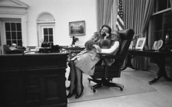 ourpresidents:  Celebrating the life of Betty Ford, April 8, 1918 - July 8, 2011 First Lady Betty Ford and daughter Susan share the President's chair in the Oval Office. December 8, 1974. -from the Ford Presidential Library and Museum