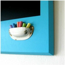 Finally! Everyone loves the chalkboard walls and whatnot, but how to store the chalk nearby? Love this idea.