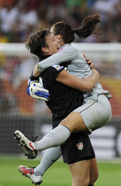 fuckyeahwomensfootball:  USA's goalkeeper Hope Solo (R) celebrates with USA's striker Abby Wambach after the quarter-final match of the FIFA women's football World Cup Brazil vs USA on July 10, 2011 in Dresden, eastern Germany. AFP PHOTO / ODD ANDERSEN (via World Soccer - Photo Gallery - Yahoo! Sports)