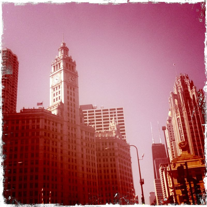 The Tribune Building and the Wrigley Building sit on either side of one another, right on the Chicago river.  They both showcase the beautiful Chicago neo-gothic style that made the city famous for its architecture.