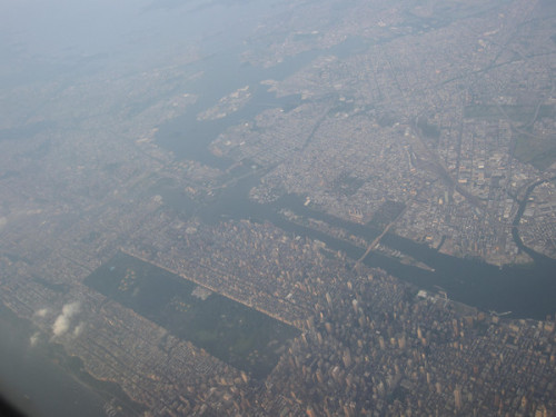 braiker:  Manhattan from above, as you approach JFK. That long rectangle in the middle is Central Park. Roosevelt Island is that thin slip of land between Manhattan and Brooklyn/Queens at the top of the photo. Whattatown!