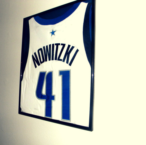 I frame my Dirk jersey and hung the bitch up..BOW!