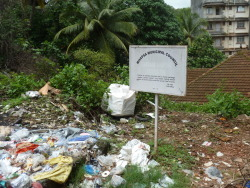 The sign reads- Garbage Dumping Prohibited. Mapusa, Goa, India.
