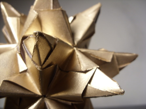 Gold Painted Stellated Dodecahedron Modular Origami Link : http://www.etsy.com/listing/77567876/gold-painted-great-stellated