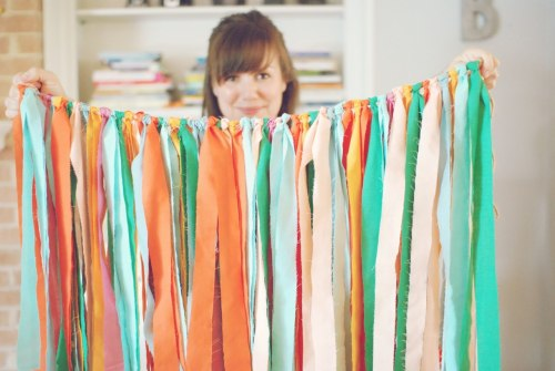"Super cute fabric streamers from My Life {as a Sugar Lander}      ""handmade: look at this awesomeness"" ""When I  think of something I want to make, I have to start on it as soon as  possible, or I think I may go crazy thinking and rethinking.  I wanted  to make some streamers, and ta da!!  You could use ribbon, but I chose  fabric, cut into fabric strips, and looped onto twine.  I did it in  maybe 30 minutes.  It will look great hanging in a doorway.  And, in a  pinch, it could be a skirt.  ;)  Or not.""-My Life {as a Sugar Lander}"
