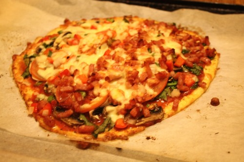 effyeahhealthyfood:  cauliflower dough pizza servings: 8 (1 slice), calories: dough on it's own is around 55 calories per serve, with sauce it is about 60 calories per serve and the rest depends on toppings. i added ham on half of mine cause my boyfriend isn't vegetarian :3. ingredients: cauliflower dough:1 cup of riced (or mushed) cauliflower1 cup of low fat mozzarella cheese1 eggsome oreganosome parsleysome basil sauce:1 can of whole tomatoes1 tsp of italian herbs topping:whatever vegetables you like and meat if you want it (though a lot less calories without it) personally i had spinach, capscicum, onion, shallots, mushrooms and 1 sliced tomato and a little bit of cheese on top. directions: preheat the oven to approx 230C (450F). boil the cauliflower until soft enough to mash. once soft drain and put in a bowl and then either mash or grate (i mashed it). add the cup of cheese and the egg and either put it through a processor, just mix it with a spoon or use a beater/chopper on it. i used a chopping/beater cause the processor didn't work ^^ it just means it will be a lot smoother and not have chunks of cheese in it. cover an oven pan with baking paper and smooth the cauliflower dough into a pizza shape, sprinkle with some organo, parsley, and basil and place in the oven for approximately 15 minutes. while the dough is in the oven cut up your vegetables for the top. open the can of tomatos and drain it with a strainer so you only have the whole tomatoes left. put these tomatoes through a blender/processer/or chop until small enough to make into a sauce. heat the sauce in a small sauceman over low heat and add some italian herbs and a small amount of corn flour to thicken, bring to the boil. once the dough is ready remove, and spread the sauce over it. add your chopped up vegetables and a little bit of the low fat mozzarella cheese on top. put back into the oven until the cheese is melted and serve!