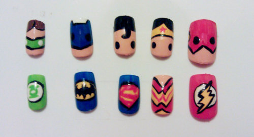 fashiontipsfromcomicstrips:  Manicure Monday: Justice League nails, by MaryMars. The cutest Justice League manicure EVER.