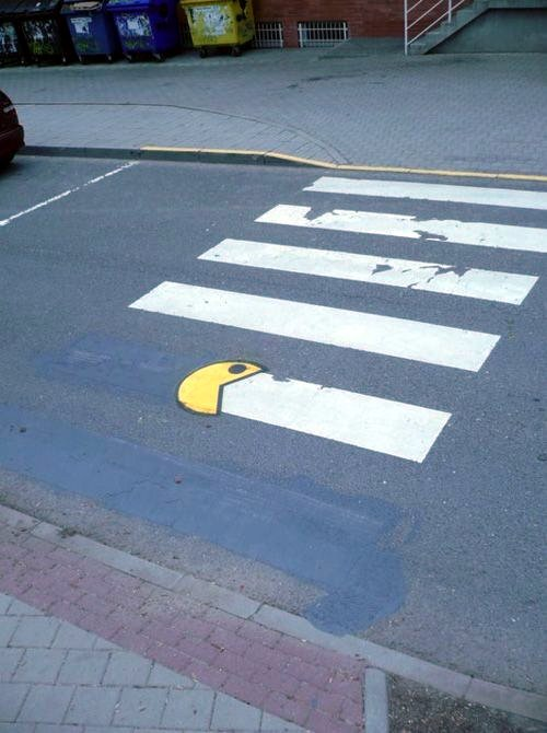 "street-art:  street om nom nom nom (via kajai)  Oh my god, this ""gamification"" thing is REAL"