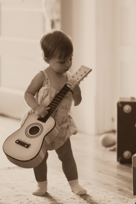 It is in her nature to make music. It's up to you to introduce her to the joy of socks on a wooden floor. (photo: dearbabyblog)
