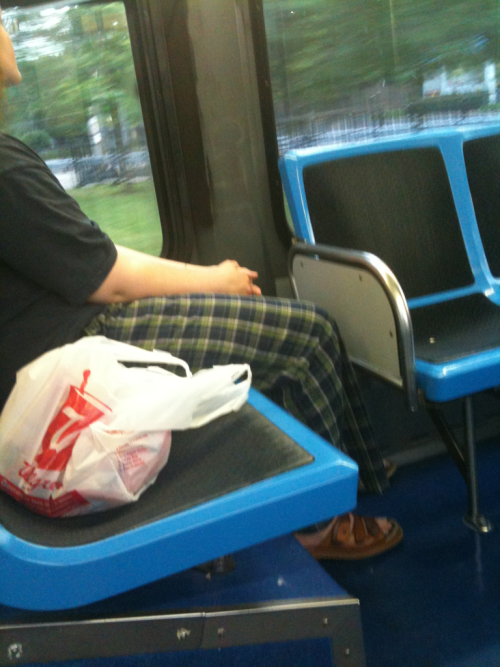 "Pajama pants in public. Clunky ""mandal"" leather shoes…  NEW GAME: man or woman?   Answer: sadly, this is a woman… And in her 20s too! What a shame, what a shame! Just as leggings are not pants… Pajamas in public are not appropriate over the age of 3!"