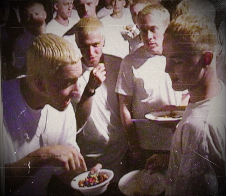 Eminem eating M&M with others Eminems  M&Ms …. how did yall miss that lol
