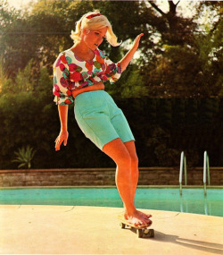 Patti McGee was the first pro female skater, the first to win the national female championships, and the first female inducted into the Skateboarding Hall of Fame.   Patti McGee is awesome.  She owns a shop in the town where my mom still lives and autographed this picture for me when I was a teenager.  It's hanging in my kitchen now (next to my collection of Fridas) so my daughters and I get to eat breakfast with badass ladies every day.