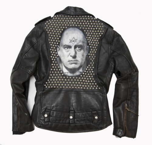 Aleister Crowley Jacket. Charcoal, acrylic, and 355 metal studs on vintage leather jacket. 2011.