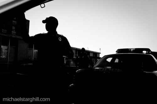 6:58 A.M. — Officer C.J. Leo takes a look under the hood to check the vitals of his squad car before he goes out on patrol Thursday April 29, 2010 at the Protective Services Police Department in SE Washington DC.