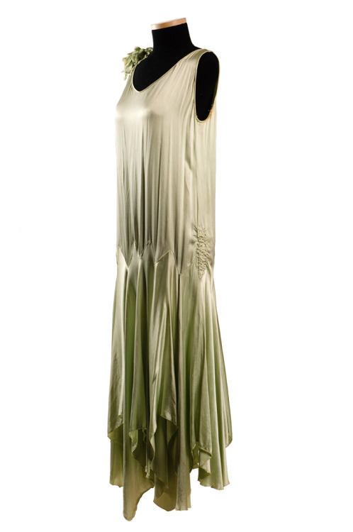 "charlestonmuseum:  Mint green rayon dress, 1920s, worn by Jeanette W. Rubin (1894-1982, Mrs. Louis D. Rubin, Sr.) of Charleston and Richmond. The ""flapper"" style dress is shirred at the sides of the low waistline and has a delightful picot-stitched handkerchief hem. The picot stitch, a loop of thread between blanket stitches, was often used for binding the bottom edge of soft garments.What shapes this dress so beautifully is the bias cut of the fabric. Perfected by French designer Madeleine Vionnet, the bias cut was used extensively on 1920s dresses, adding elasticity (so no fastener was needed) and allowing the skirt to fall in graceful fluted folds.This dress was made of artificial silk, called rayon after 1924. In 1894, British inventors, Charles Cross, Edward Bevan and Clayton Beadle, patented a safe, practical method of making artificial silk or viscose rayon. It was first commercially produced in the United States in 1910.Jeanette's husband, after moving to Richmond from Charleston in the 1930s, became a self-taught weather expert known in Virginia as ""The Weather Wizard"" for his extremely long range predictions and published a book about cloud formations. Her son, Louis D. Rubin, Jr. is a well-known historian, literary critic and novelist.2000.009.001TEXTILE TUESDAYS: Each Tuesday we post a piece from our textile collection.  Some items have been on exhibit, some will eventually be shown in our new Historic Textiles Gallery and some may be just too fragile to display. We hope you enjoy our selection each week – do let us know if there's something in particular you'd like to see on TEXTILE TUESDAY! #TextileTuesday  This is probably from about 1928-30"