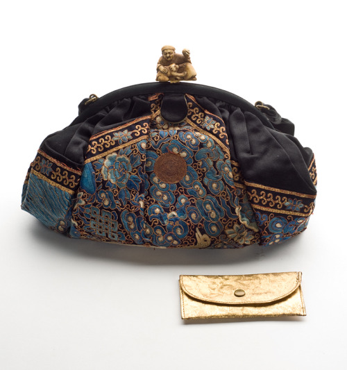 Black satin purse, almost entirely covered with silk embroidery, Oriental, early 20th century. Probably made from a panel made for the export market, this beautifully designed embroidery has motifs typical of Chinese workmanship. The ivory Netsuke (man, monkey and ball) clasp is probably from Japan. The bag is lined with changeable silk (pink/gray), has two gathered pockets inside and also contained a gold leather wallet when it was given to the Museum. The 1917 penny found inside also helps date it. This lovely accessory was given to the Museum in 1979 by Gertrude Sanford Legendre (1902-2000); she or her mother may have owned it. Click here to learn a little bit more about Mrs. Legendre.HT 5771TEXTILE TUESDAYS: Each Tuesday we post a piece from our textile collection.  Some items have been on exhibit, some will eventually be shown in our new Historic Textiles Gallery and some may be just too fragile to display. We hope you enjoy our selection each week – do let us know if there's something in particular you'd like to see on TEXTILE TUESDAY! #TextileTuesday