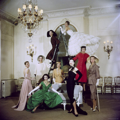 Models posing in new Christian Dior collection, 1947.