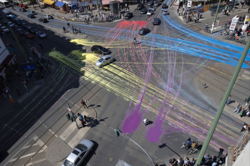 "architizer:  ""Painting Reality"" is an act of guerilla art, where cars are the paintbrush and the paint is water-based/ environmentally friendly (and comes in bright colors, too!). Click through for video!  I would love to see this in downtown Fort Wayne. We might really see how active downtown is. Be sure to include the bike lanes too!"
