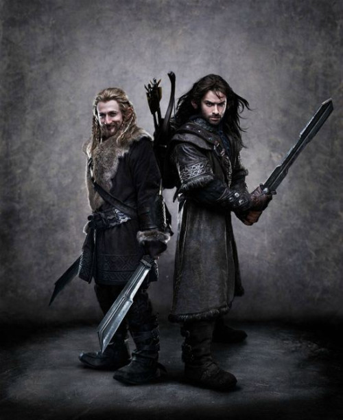 "(via Fili and Kili Revealed in The Hobbit: An Unexpected Journey - ComingSoon.net) MSN has this first look at Dean O'Gorman as Fili and Aidan Turner as Kili in The Hobbit: An Unexpected Journey. Two of the youngest dwarves, Fili and Kili have been born into the royal line of Durin and raised under the stern guardianship of their uncle, Thorin Oakensheild. Neither has ever travelled far, nor ever seen the fabled Dwarf City of Erebor. For both, the journey to the Lonely Mountain represents adventure and excitement. Skilled fighters, both brothers set off on their adventure armed with the invincible courage of youth, neither being able to imagine the fate which lies before them. [Image description: Fili has Legolas hair (seriously, it may actually be a Legolas wig, with the blond and the braids and whatnot) and like some kind of fur pimp collar on his dwarfwear and a smirk. Kili has glowerbrows and dark hair blowing back for… some reason. They both have dwarven machete swords, and Kili also has a bow and quiver, which makes me think he may be the filling the Legolas Action Slot until Actual Legolas shows up—wait, wait, Fili has TWO swords. So they are definitely the Legolai of The Hobbit.] [The other dwarves are ashamed of their beard-lacking.] @cleolinda: Ah, the hot dwarves. RT @comingsoonnet: Fili and Kili Revealed in The Hobbit: An Unexpected Journey@LJmysticowl: @cleolinda There's some distinct dwarf-elf interbreeding going on with Kili, he didn't get that ""I make my own wind"" hair from Uncle Thorin."