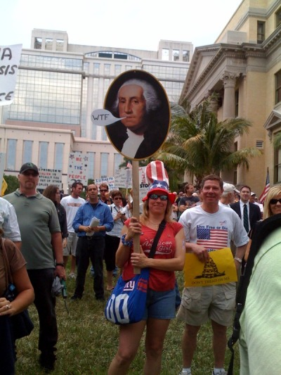 "(A woman holds a sign with a picture of George Washington saying ""WTF"" at the South Florida Tea Party ""Tax Day"" Rally, West Palm Beach, Fla., April 15, 2010. Many Tea Partiers claim that George Washington and other Founding Fathers would be unhappy with the current state of the Union. The Founders indeed favored limited government, and were skeptical of executive power, but they clashed sharply over the extent of those limits. - By Jessica Chasmar)"