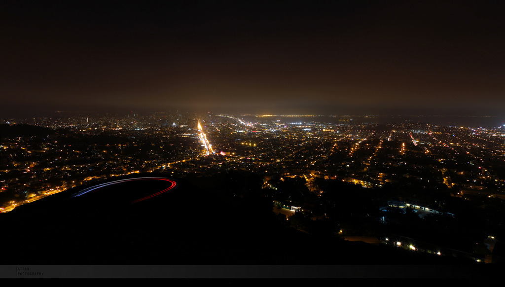 View of Market St. and the rest of the city from Twin Peaks at night. After our failed attempt to see the view of the city (described here), the fog cleared out the last night I was in SF. I literally jumped out of the car with my camera and tripod when I saw the view when we stopped at the top. My family came out to see the view too, but after a few minutes they we back in the car. I was still out in the cold taking shots :P I was waiting for the perfect moment where some cars were driving down the road. This literally was the best way to end my trip :) Hopefully I will be returning soon.